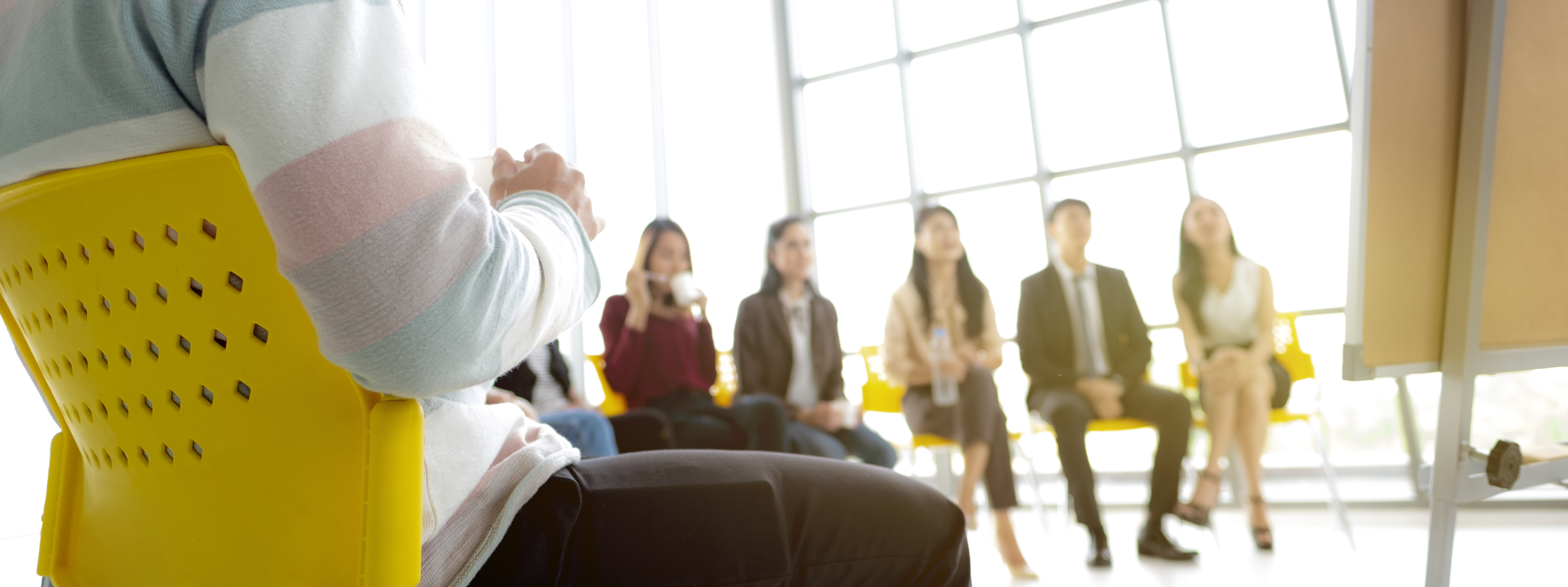Group of Coworkers Undergoing Sexual Harassment Training