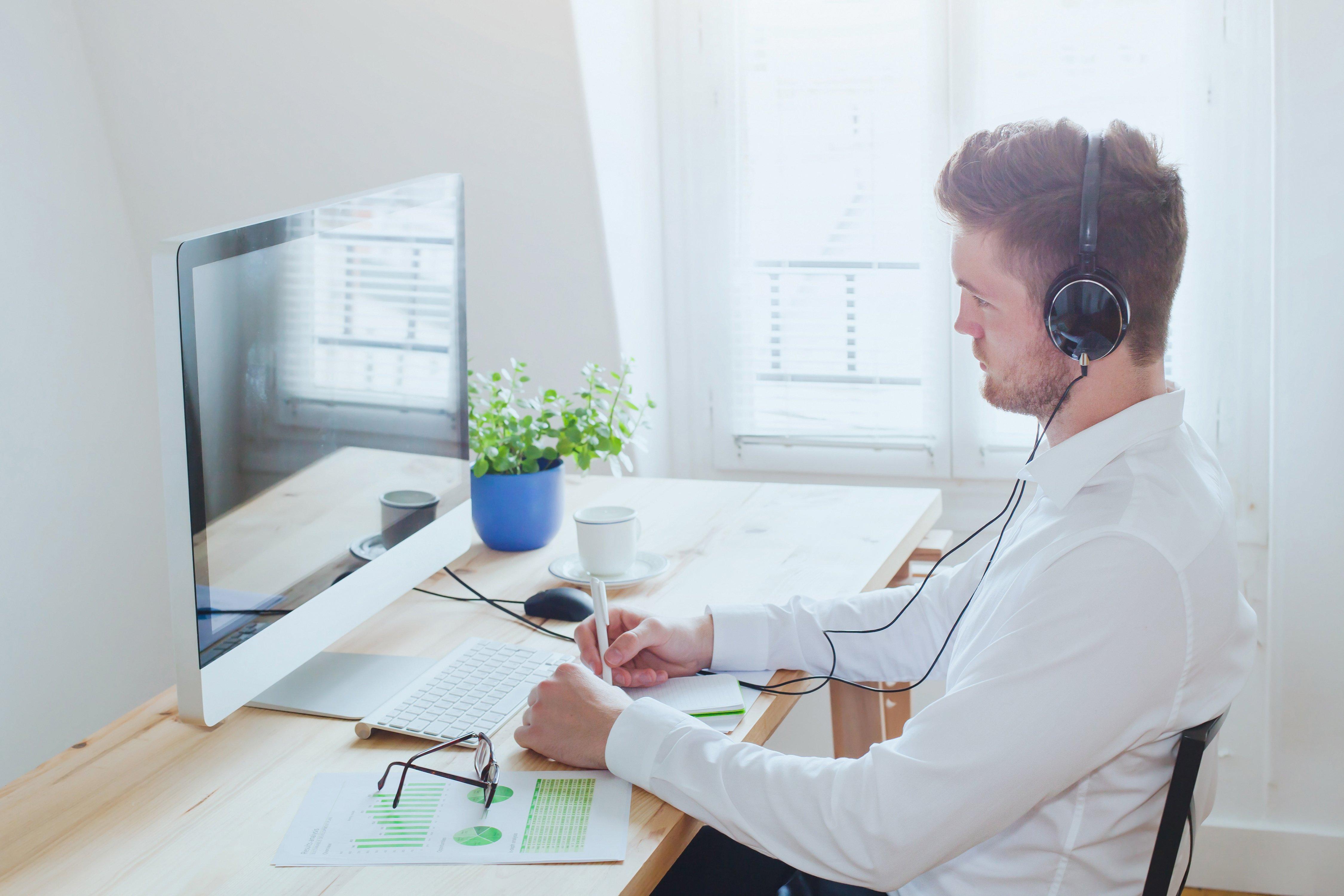 Man taking online training at desk