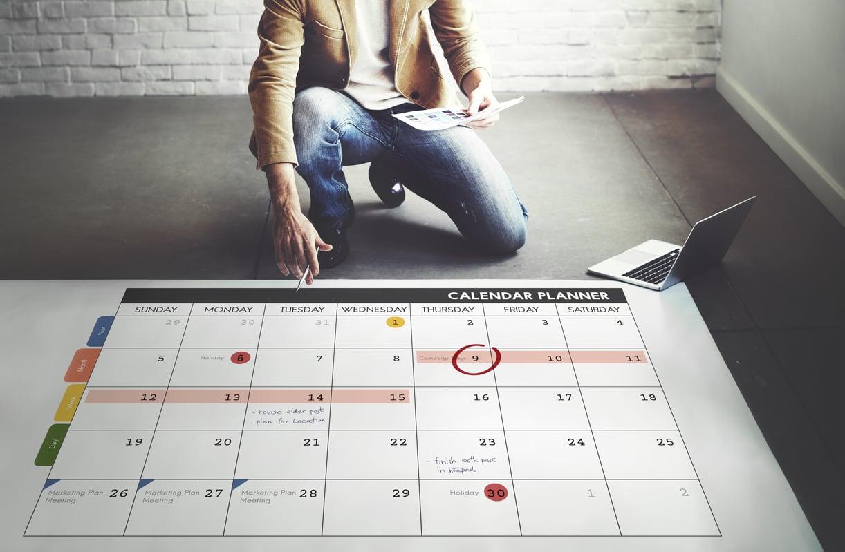 Man with Calendar creating a timeline.