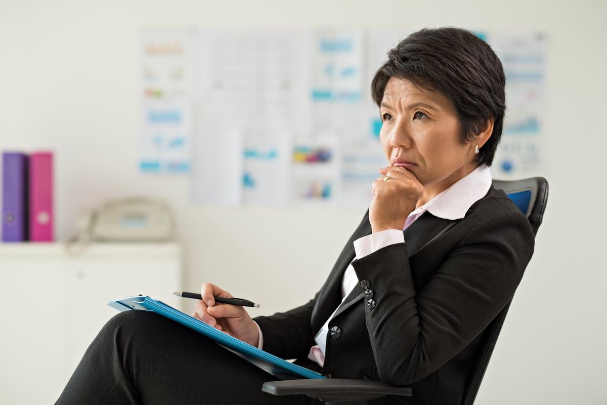 Business Woman Considering Windows 10