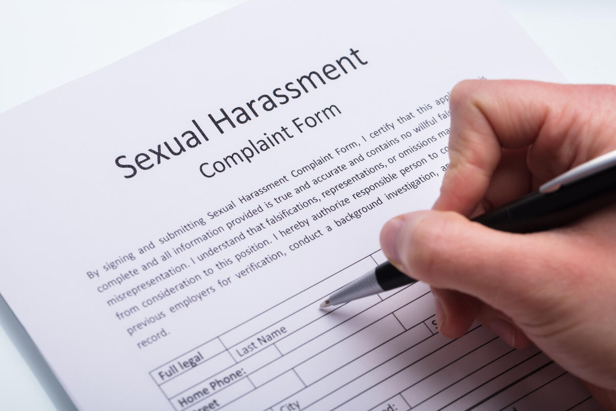 Person filling out a Sexual Harassment Complaint Form