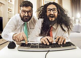 2 enthusiastic nerdy guys working simultaneously on a document with other authors