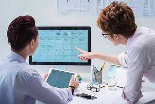 AdobeStock_business_associates_computer_calendar_small.jpg