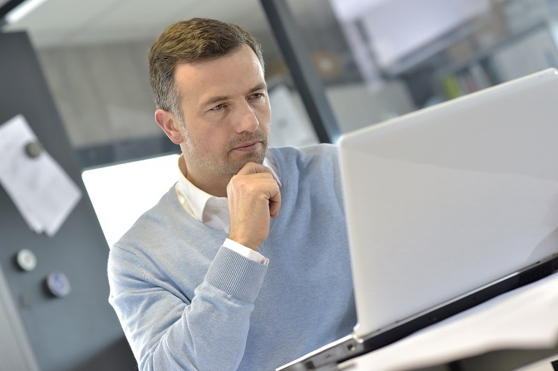 AdobeStock_thoughtful_man_at_computer_small